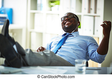 Resting during work - Office worker listening to music at ...