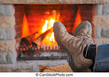 Resting Feet Beside the Fire Place