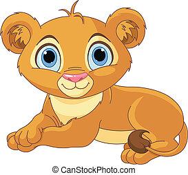 Image of resting little lion cub
