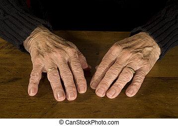 old hands - resting old hands