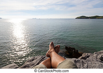 Resting on the edge of a cliff