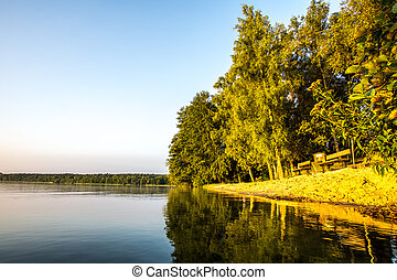 Resting place at a lake at sunrise