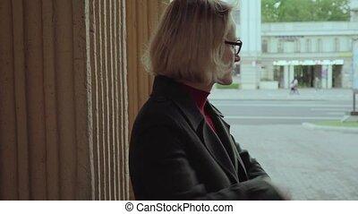 Restless sad woman near wall at city street - Restless sad ...