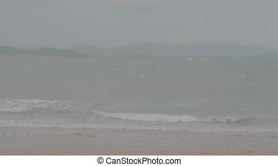 Restless sea during cloudy day - View from the beach on ...