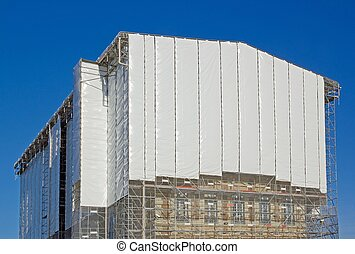 restoration of a castle in the Paris region white tarpaulin...