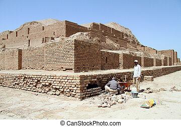 Restoration of brick ziggurat Choqa Zanbil near Shush, Iran
