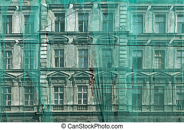 restoration of the facade under green net