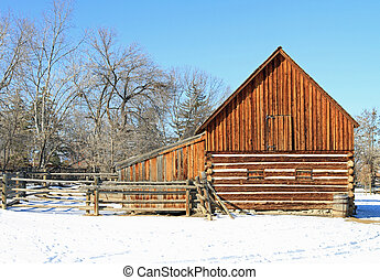 Restored 1860s barn, surrounded by snow in the winter