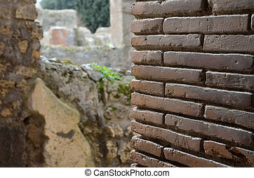 Restored brick wall in the ancient ruins