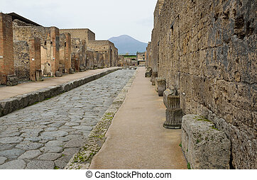 Restored city Pompeii - Ancient paved street is recovered in...