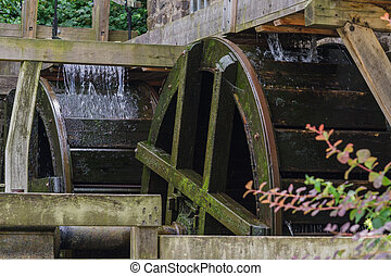 Reconstituted and restored mill wheel of an old water mill in Germany.