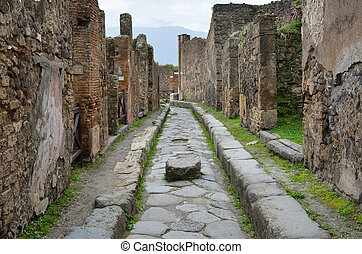 Restored ruins in the ancient city Pompeii - Ancient paved...