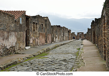 Restored street in the ancient city Pompeii