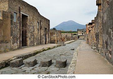 Restored street in the ancient city Pompeii - Ancient paved...