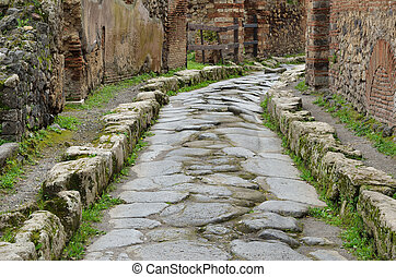 Restored street in the ancient Pompeii