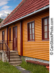 Restored wooden house - Fragment of restored wooden house in...