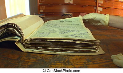 Restorers restore old archival documents, books and...