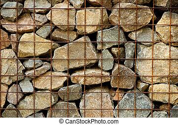 Restrained Rocks - Mesh wire restraining rocks as in a wall