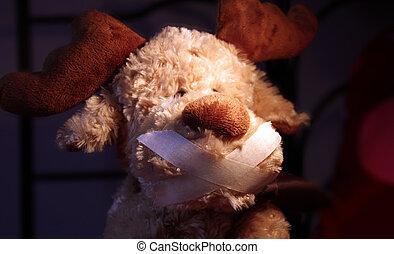 restrained stuffed animal