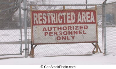 Restricted area. 2 shots. - Restricted area sign with snow...