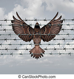 Restricted freedom concept and constrained opportunity symbol as a bird caught and entangled in a barbed wire fence as an icon for frustration and suppression.