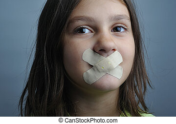 Restriction - Portrait of a girl with plasters over her lips