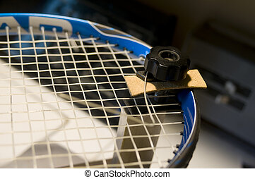 restring tennis racket - a tennis racket (racquet) being...