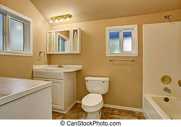 Restroom interior with beige walls. Refreshing white vanity cabinet