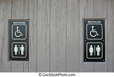 Restroom signs - Pair of restroom signs on a wall