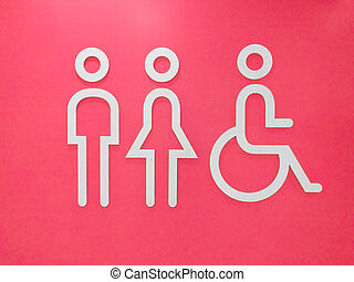Restroom signs with a disabled access symbol on pink background