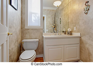 Restroom with white vanity cabinet - Restroom interior with...