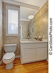 Restroom with white vanity cabinet