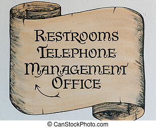 """""""Restrooms Telephone Management Office"""" sign"""