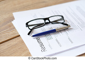 Resume application on wooden desk ready to be reviewed
