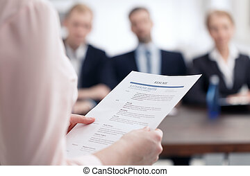 Resume for corporation job - Woman holding her resume for...