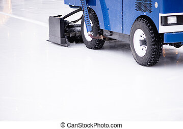 Resurfacing machine cleaning ice of hockey rink. Copy space.
