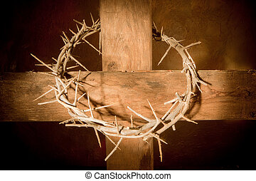 Crown of thorns hanging on a wooden cross at Easter