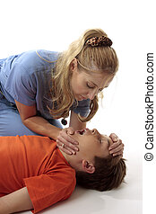 Resuscitation - A nurse performing mouth to mouth...