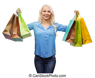 smiling woman with many shopping bags - retail and sale ...