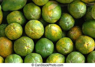 Retail Background of Fresh Papayas