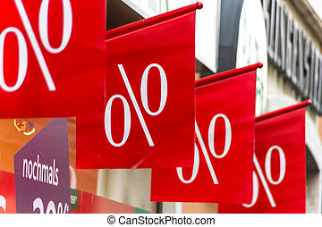 retail price reduction percentage, symbolic photo for low prices, marketing and competition
