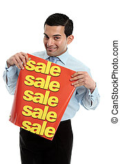 A happy and friendly smiling retail salesman holding a sale sign banner. White background.