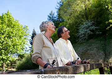 Retired but active couple enjoying the greenery - Active...