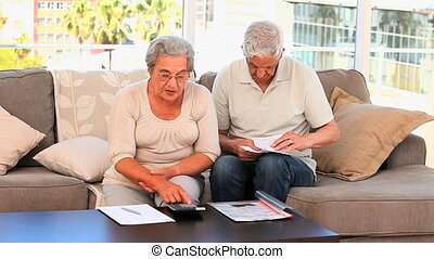 Retired couple calculating their do