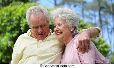 Retired couple embracing each other