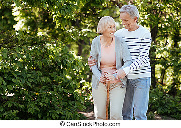 Retired couple enjoying promenade in the park