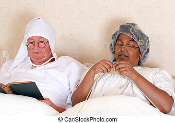 Retired couple in bed - Retired couple reading and knitting...