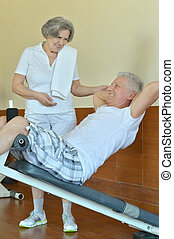 Retired couple in gym