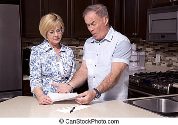 retired couple in the kitchen