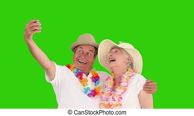 Retired couple in vacacion shooting themself